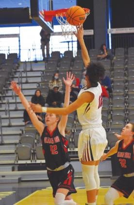 Watonga's Kiylah Cooper goes up for an easy two points in a game earlier this season. The Lady Eagles only managed one game in the past week, losing a close 62-59 OT game to Cashion. Brenda Geels Watonga Republican