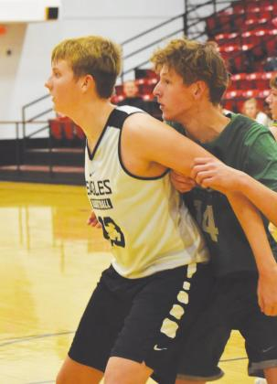 (Photo above) Tucker Estep goes for the shot during a scrimmage against Amber-Pocasset. (Photo below) Tucker Estep blocks a player during a scrimmage against Amber-Pocasset.