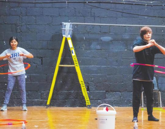 Jacks Bates (left) and Nathaniel Woods (right) compete to see who can hula hoop the longest. (Photo provided)