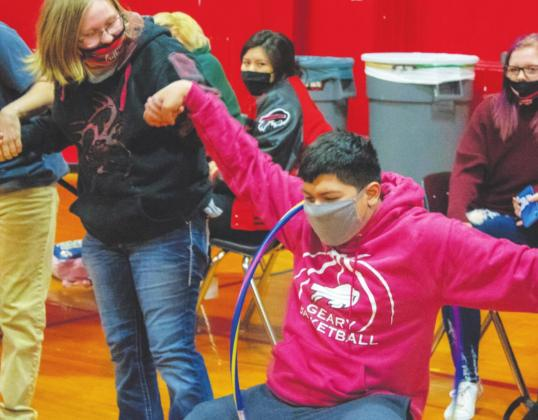 Pedro Covarrubias attempts to get a hula hoop to another student during Spirit Week activities. (Photo provided)